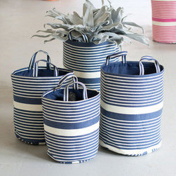 Striped Woven Baskets in Navy - Set of 4 - You'll find a hundred uses for these sturdy, handsome woven baskets. The navy and cream stripe pattern makes for an attractive organizational tool. They would be great left on display as quick storage.