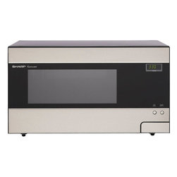 "Sharp - Sensor Microwave Oven - The Sharp R426LS 1.4 Cu. Ft. 1100W Sensor Microwave Oven has it all whether it is used for lavish entertaining or daily favorites. In addition to its clean and uncluttered stainless steel design, its features include many options for sensor cooking, heating and defrosting. The control panel is located behind the oven's door so that it is hidden from view but easy to reach. A generous 14.1 inch turntable accommodates a large casserole dish. Plus, the 11 variable power levels vary cooking speed for everything from fast reheating to delicate sauces. Features: -Colour: Stainless steel. -Oven capacity: 1.4.cu.ft.. -1100 Watt microwave oven. -14.1"" diameter turntable. -7-Digit with 2 color lighted display. -19 Automatic settings. -11 Variable power levels. -4 Defrost options. -9 Smart and easy sensor settings. -Popcorn sensor. -Keep warm plus. -Manufacturer provides one year warranty. Specifications: -Clock, kitchen timer, child lock and demo mode. -Package Contents: microwave oven, turntable, turntable support and manual. -Overall dimensions: 12"" H x 21"" W x 17"" D."