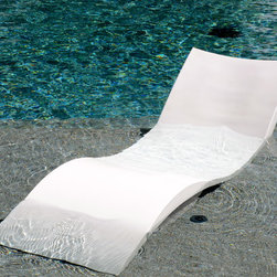 Ledge Lounger - The Ledge Lounger is a lounge chair specifically designed to allow relaxation/sunbathing while on pools tanning ledge, baja shelf or sun deck.  Its fine contours support the body, Stacks easily for storage, and its Color Stabilized for UV resistance/Chemical & Weather-defying resistance