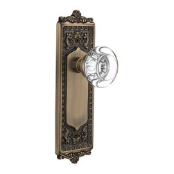 Nostalgic - Nostalgic Passage-Egg and Dart Plate-Round Clear Crystal Knob-Antique Brass - With its distinctive repeating border detail, as well as floral crown and foot, the Egg and Dart Plate in antique brass resonates grand style and is the ideal choice for larger doors. Adding our Round Clear Crystal Knob, which features a circular shape that magnifies the beautiful facets underneath, only serves to bring the past alive. All Nostalgic Warehouse knobs are mounted on a solid (not plated) forged brass base for durability and beauty.