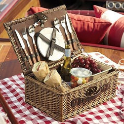 """Picnic For 2 basket - Woven of textural natural rattan, this classic basket includes everything you need for a picnic - plus plenty of room for food and wine. Lined with cotton canvas and filled with two wine glasses, two plates, flatware and a wine opener, it makes a perfect gift for a summer wedding. 17"""" wide x 11"""" deep x 7"""" high Basket is woven of willow and is detailed a cotton canvas lining. Flatware is made of wooden handles and stainless steel blades. Set includes a basket, two ceramic plates, two wine glasses, two sets of 3 piece flatware (fork, knife & spoon) and one wine bottle opener."""