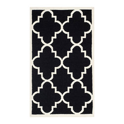 Safavieh - Dhurries Black and Ivory Rectangular: 5 Ft. x 8 Ft. Rug - - This distinctive piece is both stylish and incredibly soft to the touch with bold rich colors that complement any room. Flat-woven by hand in India  - Pile Height: 0.25  - Construction: Flatweave  - Shedding is a normal occurrence and will reduce over time with frequent vacuuming. It is also recommended that you vacuum regularly to prevent dust and crumbs from settling into the roots of the fibers. AVOID DIRECT AND CONTINUOUS EXPOSURE TO SUNLIGHT. USE RUG PROTECTORS UNDER THE LEGS OF HEAVY FURNITURE TO AVOID FLATTENING PILES. DO NOT PULL LOOSE ENDS, CLIP THEM WITH SCISSORS TO REMOVE. TURN CARPET OCCASIONALLY TO EQUALIZE WEAR. REMOVE SPILLS IMMEDIATELY ; IF LIQUID, BLOT WITH CLEAN, UNDYED CLOTH BY PRESSING FIRMLY AROUND THE SPILL TO ABSORB AS MUCH AS POSSIBLE. FOR HARD TO REMOVE STAINS, PROFESSIONAL RUG CLEANING IS RECOMMENDED. STORE IN A DRY, WELL-VENTILATED AREA. USE OF A RUG PAD IS RECOMMENDED. Safavieh - DHU633A-5