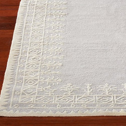 Teza Rug - Add plush softness to a room with this romantic, intricately framed design.