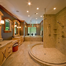 Rustic Bathroom by HELMAN SECHRIST Architecture
