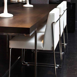 Astoria Chair by Nuans Design - Whether it's seen from the side, front or back, the shape of the Astoria Chair is simple but stunning. From the side view, it's possible to see the distinctive detailing of the chrome sled base and back. Doesn't it look amazing in white faux leather?