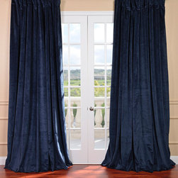 EFF - Midnight Blue Velvet Blackout Extra Wide Curtain Panel - Give your decor a sophisticated look with this 100-inch wide curtain panel. The poly velvet construction and thermal lining of this blackout panel offers durability while blocking out disruptive light. A rod pocket design allows for quick installation.