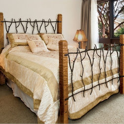 Mathews & Company - South Fork Wrought Iron Bed - Enjoy a woodsy, antique, yet sturdy look in your bedroom by furnishing it with this South Fork Wrought Iron Bed. Each hand made bed is artistically put together by one of our artisans and comes in several sizes. Natural pieces of carved wood form the four corners of the bed frame and are creatively joined together at the headboard and footboard by hand forged pieces of iron. Make your guest bedroom or your own bedroom cozy and warm by adding this bed that makes a unique decoration as well as a useful piece of furniture. Pictured in Black finish.