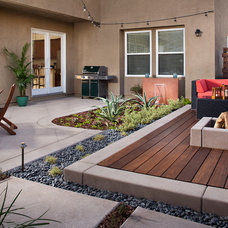 Contemporary Landscape by Promised Path Landscaping Inc