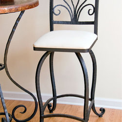 """Mathews & Company - Alexander 25"""" Swivel Counter Stool no Arms - The graceful, fluid lines of the stool, combined with the hand-crafted iron scrollwork of the feet and seatback evoke an organic, vine-like quality, and will coordinate perfectly with your other furniture and accessories in the Alexander line. The feet are carefully padded to protect your floor, and the amply padded cloth or leather seat provides a comfortable seating experience. You can even choose a solid pine seat for a more rustic look. Each piece is hand-crafted by the skilled iron artisans of Mathews & Co., ensuring the highest quality, both in appearance and durability. Pictured in White Cloth upholstery and Black finish."""