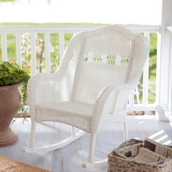 Coral Coast - Coral Coast Casco Bay Resin Wicker Rocking Chair - CWT119R-HONEY - Shop for Chairs and Sofas from Hayneedle.com! Season after season you'll enjoy the beauty of the outdoors from the comfort of your Coral Coast Casco Bay Resin Wicker Rocking Chair. Featuring a nicely sized seat and supportive backrest this charming outdoor rocking chair is made of durable resin wicker so it's highly weather-resistant and practically maintenance-free. If it gets dirty just spray with a hose and wipe dry. Featuring a classic wicker weave and a warm traditional style this outdoor rocker provides comfortable seating for a porch patio poolside or even a sunroom. It's available in your choice of finish. About Coral Coast What if when you closed your eyes you pictured yourself in your own backyard? Coral Coast has a collection of easygoing affordable outdoor accessories for your patio pool or backyard. The latest colors and styles mingle with true classics in weather-worthy fabrics and finished woods ready for relaxation. Make yours a life of leisure.