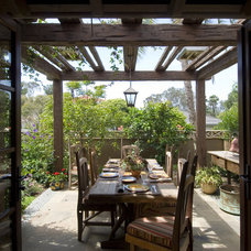 Rustic Patio by Mulvey Custom Builders