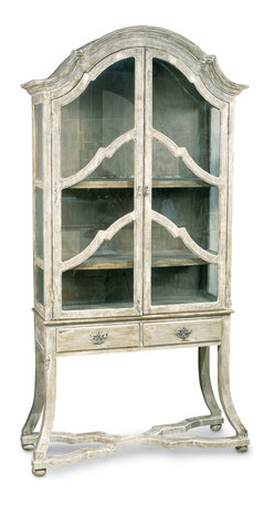 Dutch Cabinet With Glass Doors & Drawers - Cherished treasures are all the more precious when displayed in this glass-fronted cabinet.  A beautiful choice for a china hutch or curio cabinet, this glass-fronted vitrine armoire stands on slender flared legs and features an arched top with rich crown molding, double framed doors closing over three deep shelves, and a pair of drawers beneath to tuck small linens or other necessities.  All of the woodwork has been given a labor-intensive artisan rubbed whitewash finish, with elegant hardware to match.
