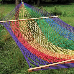 Twin Oaks Hammocks - Twin Oaks XL Classic Colored Rope Hammock - 10155 - Shop for Hammocks from Hayneedle.com! The traditional southern-style Twin Oaks XL Classic Colored Rope Hammock is one of our most popular products. Hand-woven from custom-formulated olefin rope these hammocks are designed to resist UV damage mildew and rot. The yarn is solution-dyed to ensure long-lasting colors with a variety of options available: Red Carrot Lemon Holly Pine Pacific Navy Purple Black White Sandstone and Rainbow Stripe. The spreader bars are crafted from white oak that has been hand-finished with linseed oil to preserve the beauty of the wood grain. Twin Oaks hammocks are the finest in the world. Sourced manufactured woven and assembled in rural Virginia these hand-crafted hammocks manifest the pride that members of the Twin Oaks community take in their work and in their commitment to your satisfaction. Constructed of tough weather-resistant material and easy to clean these premium-quality Twin Oaks products will last for years. Wash with warm water and a mild detergent. All products are guaranteed against manufacturing defects for two full years from the date of purchase. About Twin Oaks Hammocks Twin Oaks believes quality starts at the beginning in every fiber of every rope and in every grain of every log. They start with yarn specially chosen for weather-resistance and colorfastness and twist it into durable rope in all colors of the rainbow. Twin Oaks' spreader bars begin as locally harvested white oak logs which they mill and kiln-dry on site for well-seasoned outdoor use. The completed spreaders are hand-brushed with natural linseed oil and air-dried to maintain the beauty of the wood grain. Macrame harnesses are made by hand and carefully measured and trimmed so that every hammock is stable and comfortable. Twin Oaks' craftsmen weave each rope hammock using techniques and equipment designed to be easy on the body and to minimize waste. Finally at least 40 expertly tied b