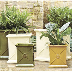 Ballard Designs - Beauclaire Planter - These are pretty and classic planters with crest detailing. I love the yellow one.