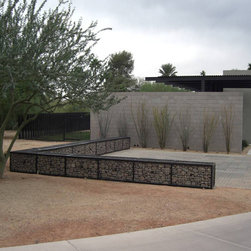 ECO-ROCK™ Wall Systems - This private residence in Arizona uses McNICHOLS' ECO-ROCK™ Wall System to create a low rock-filled fence for this outdoor area.