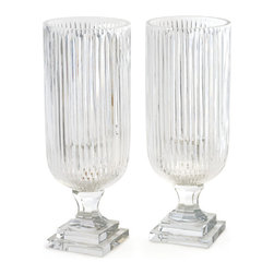 Pair of Linear Hurricanes - This Pair of Linear Hurricanes is made of crystal. These look elegant and stately and will make for an ethereal and sublime decor in your parties. The vertical cut pattern spread all over the hurricanes looks exquisite.
