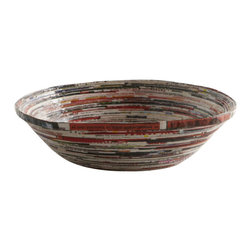 Recycled Bowl - Eco-friendly and functional, these colorful bowls are handmade in Kenya and Uganda from recycled magazines. Due to their handmade nature, each bowl is one of a kind, with a unique color and look.  Utilize as a catch all for keys and office supplies, or tack multiples to the wall for an individualized art installation.