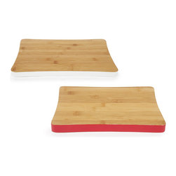 Accent Cutting Boards - Set of 2 - Prep your next meal on gorgeous minimalist cutting boards. Made from renewable bamboo, the versatile small and medium cutting boards won't dull knives, are long-lasting and are almost entirely maintenance-free. Take the set from kitchen to table.