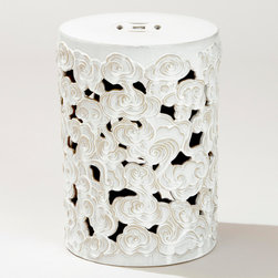Tibetan Cloud Ceramic Drum - I love this flower-form table because the flowers remind me of Matisse.