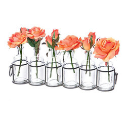 Sextet Bottle Vase - By arranging its six glass bottles in a line, this gently rugged vase gives you a whole centerpiece, or a shelf's worth of color, all at once. Fill it with tumbled pebbles or flower buds of your choosing to create a colorful contrast to the hardy, antiqued metal frame.