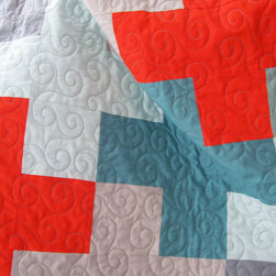 Baby Quilt, Modern Plus Design by Never Not Quilting - This baby quilt features Swiss crosses in a mix of red, teal and gray. It has a handmade modern style that would be a sweet gift for a baby girl or boy.