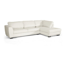 Wholesale Interiors - Orland White Leather Modern Sectional Sofa Set with Right Facing Chaise - Spacious. Sleek. Urban. The sizable Orland Sectional Sofa is classy and contemporary with a youthful vibe. Each of the two pieces included with this set is made with a wooden frame, firm foam cushioning, and soft white bonded leather. The backrest cushions are removable and secure to the frame with Velcro strips. The sofa and chaise are freestanding pieces that do not adhere to one another. Black plastic legs with non-marking feet finish off the look. The Orland Living Room Sectional is made in Malaysia and should be wiped clean with a solvent of mild detergent and water. This style is also offered with the chaise on the opposite side as well as both configurations in brown bonded leather (each sold separately). Minor assembly is required. Overall dimensions: 116.5 inches wide x 79 inches deep x 32.5 inches high. Sofa dimensions: 79 inches wide x 34 inches deep x 33 inches high. Seat dimensions: 69 inches wide x 21 inches deep x 17.5 inches high. Chaise dimensions: 37 inches wide x 68.5 inches deep x 33 inches high. Seat dimensions: 25 inches wide x 56 inches deep x 17.5 inches high. Arm height: 26 inches.