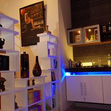 Contemporary Wine Cellar by CozyNest Interiors
