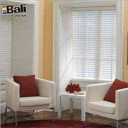 "Bali Faux Wood Blinds - Bali Economy 2"" Fauxwood Blinds. Whites and off-whites,N - Bali Economy 2"" Fauxwood Blinds - Buy with Confidence, Get Free Samples Today!For the first time ever, you can now enjoy the high quality you expect from Bali, but at an introductory low price. Buy Bali Economy faux wood blinds and you'll never have to worry about warping, cracking, or splitting in environments of high moisture or high humidity. They are also ideal for bathrooms and garages.  A 2.5"" valance is standard; or you can upgrade to a 3.5"" decorative valance for only $5 more. The durable steel headrail is guaranteed not to sag, and it has hidden valance clips for a cleaner look.  Same great quality found in other Bali products, but with more limited sizes and upgrades.Color shown in picture is Coconut C630."