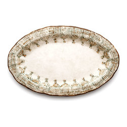 Chianti Small Oval Platter - Warm, rustic fresco neutrals fill out the background of the Chianti Small Oval Platter, while the hues of ivy leaves and sun-warmed rust are painted in delicate, expressive lines to form the distinctive Italianate look of the graceful oval platter's design. Charmingly handmade, this European ceramic serving piece expresses a suave taste for timeless crafting.