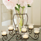 Veranda Candelabra - A stunning centerpiece wherever you place it, this creative approach to flowers and candlelight features a mouth-blown central vase with eight multi-level holders for candles, more flowers or treasures of your choice. Hand-forged of solid iron with removable glass containers.