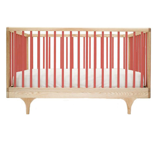 """Kalon Studios - Kalon Studios Caravan Crib Red - Kalon Studios designs nursery furniture with a focus on contemporary form, innovative style and sustainability. Inspired by a storybook circus wagon, the Caravan crib offers playful and modern elements. This minimalist baby furnishing features red slatted sides, two adjustable mattress heights and the option to convert to a platform toddler bed. Made in the USA from FSC-certified maple and low VOC, HAPs-free paint. Due to handmade and natural quality, slight color and grain variation may be present. 54.5""""W x 30""""D x 34""""H. Fits standard crib mattress (not included). Conforms to ASTM, CPSC and Health Canada regulations. Glue contains zero formaldehyde and exceeds European E1 and California emission standards by 3 times. Green guard certified."""
