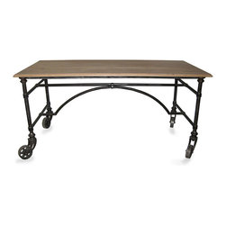 Desk with Wheels - Metal - Slim arches and practical bracing form a poetic sketch in dark metal below the Desk with Wheels, an attractive piece that looks back to the elegant beginnings of urban style. At home in traditional or eclectic interiors, this handsome desk combines the darkness of iron with the authentic elegance of natural wood, subtly beveled around the edge for a cultivated border.