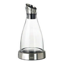 Frieling - Flow Carafe, 34 oz. - Serve refreshing ice tea, crisp lemon water or any other chilled beverage in this sleek carafe. Besides the visual appeal, you can enjoy a neater countertop too: Just return the carafe to its thoughtful cooling station.