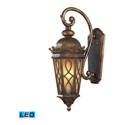 Elk Lighting - Burlington Junction LED 2-Light Wall Bracket in Hazelnut Bronze - Located on the eastern shore of lake champlain between the adirondack and green mountains, burlington is charming and idyllic. This series was inspired by this quaint city by the lake that prides itself in the arts. The fine craftsmanship of this collection is evident in the cast aluminum details and scrollwork. This series is available with two glass options; a clear seeded glass or amber scavo glass. - LED, 800 lumens (1600 lumens total) with full scale dimming range, 60 watt (120 watt total)equivalent, 120V replaceable LED bulb included.