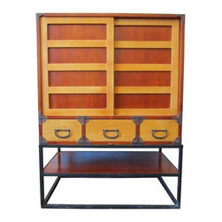 Pre-owned Vintage Japanese Tansu Cabinet - This striking vintage tansu will make a handsome addition to any space. Tansu are traditional Japanese wooden cabinets often with many compartments and sliding doors. Tansu were first created in Japan during the Edo Period (1688-1704) and have remained popular today.     Over the centuries many types of tansu have been made, often varying in style from region to region in Japan. Traditionally tansu have held many different functions and were used both in the home and places of business. Following the traditional minimalistic Japanese style of interior design, this attractive tansu is stylish as well as practical.     The piece is in great condition, a few very minor scratches on the wood on the top surface of the cabinet.