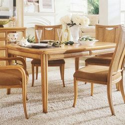 "American Drew - American Drew Antigua Leg Table Multicolor - 931-760 - Shop for Dining Tables from Hayneedle.com! Make a coastal ambience at home with the American Drew Antigua Leg Table. This table is crafted from select hardwoods and primavera veneers which makes it durable and suitable for the modern lifestyle. This dining table comes with wicker basket weave inserts that give a unique style to the table. The table can extend with the help of an extendable 20-in. leaf to accommodate larger gatherings. The rich warm toasted almond finish of this table makes it an ideal choice for your dining room. Table dimensions: 64-84L x 44W x 30H inches. This item is for dining table only please see ""related items"" for matching chairs or complete dining set. About American DrewFounded in 1927 American Drew is a well-established leading manufacturer of medium- to upper-medium-priced bedroom dining room and occasional furniture. American Drew's product collections cover a broad variety of style categories including traditional transitional and contemporary. Their collections range from the legendary 18th-century traditional ""Cherry Grove "" celebrating its 42nd year of success to the extremely popular ""Bob Mackie Home Collection "" influenced by the world-renowned fashion designer Bob Mackie. ""Jessica McClintock Home"" features another beloved designer bringing unique style to an American Drew line. American Drew's headquarters are located in Greensboro N.C. Their products are distributed through thousands of independently owned retailers throughout the United States and Canada and around the world."