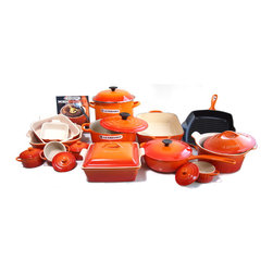 Le Creuset - Le Creuset Signature  Enameled Cast Iron 24 Piece Cookware Set, Flame - Combining iconic enameled cast iron with the most colorful cookware, this Le Creuset 24 piece cookware set will add beauty and functionality to your kitchen. This set includes Le Creuset's signature enameled cast iron three and a half quart covered French oven, a 10 inch skillet grill, a one and half quart covered saucepan, and a five and one fourth quart roaster. Designed to enhance the cooking process, these enameled cast iron pieces distribute heat evenly and lock the optimal amount of moisture. The interior enamel is engineered to resist staining and dulling, while the exterior enamel resists against chipping and cracking. Heat resistant up to 500 degrees Fahrenheit, the over-sized handles and ergonomic composite knob makes for easy handling.