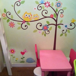 Baby's Nursery and Children's Bedroom - One Mural, Many Walls - Bird and Owl Tree Wall Mural Set. Both sophisticated and fun, you'll love livening up your walls with this tree! Featuring funky, curly branches, brightly-colored flowers, and some friendly feathered friends, our Scroll Tree is the perfect touch to nurseries, bedrooms, and playrooms. Every element is repositionable, meaning it's easy to move the tree around as you like. No need to worry about getting it perfect on the first try! There is no need for paste or water - simply peel the applique or border off the backing and apply to the wall - or any smooth surface.