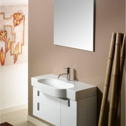 Iotti - 35 Inch Bathroom Vanity Set - Uniquely stylish, this Italian imported vanity set delivers rugged performance and abundant storage for your bath. Available in Glossy White, Glossy Black and Glossy Gray finishes, you get exactly the right look for your d�cor which will last for years. Get ample shelf space for your toiletries on the fitted white ceramic sink top. The easy access storage drawers and door have soft close mechanisms for longer life. Five layer construction lets the vanity mirror resist scratches and corrosion. Set Includes: . Vanity Cabinet (2 drawers, 1 door). Fitted ceramic sink (35 inch x 17.7 inch ). Mirror (30.4 inch x 27.7 inch ). Vanity Light (11.8 inch ). Vanity Set Features:. Vanity cabinet made of engineered wood. Cabinet features waterproof panels. Available in Glossy White (as shown), Glossy Black, Glossy Gray. Cabinet features 2 soft-closing drawers, 1 door. Faucet not included. Perfect for modern bathrooms. Made and designed in Italy. Includes manufacturer 5 year warranty.