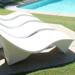 60's Arcitectural Sunlounger In White Fiberglass - These lounge chairs supply the perfect pop of white. Use these to enjoy those warmer spring days. Add a book and a beverage and I could lounge all day.
