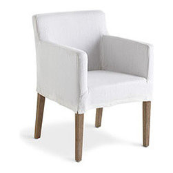 SLIPCOVERED ACCENT CHAIR - Need a chair for your dining table? A reading corner? An extra seating in a living space? Slip this versatile chair into your home to solve your seating problem. Its cover is easy-to-remove, in a neutral ivory hue, made of linen. Best of all, the frame is built with oak, so it's meant to last for years. Your problems are solved; just sit back and relax. Cover is dry-clean only.