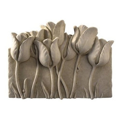 Tulip Garden Wall Plaque - About Carruth StudioWe've chosen to carry Carruth Studio designs based on their integrity and authentic dedication to aesthetics. Since 1983, sculptor George Carruth has been creating whimsical images out of limestone, concrete and clay, all with one thing in common: the ability to make people smile. With a nod toward the world of nature, Carruth's signature works include a menagerie of bunnies, cats, frogs and other delightful creatures, flowers, angels, celestial bodies and magical beings. The company is located in Ohio. We think you'll find Carruth designs lovely and interesting, a perfect choice for your outdoor area.