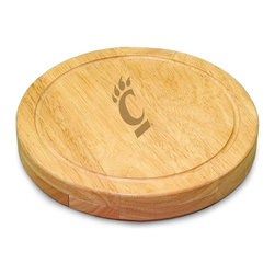 "Picnic Time - University of Cincinnati Circo Cheese Board - The Circo by Picnic Time is so compact and convenient, you'll wonder how you ever got by without it! This 10.2"" (diameter) x 1.6"" circular chopping board is made of eco-friendly rubberwood, a hardwood known for its rich grain and durability. The board swivels open to reveal four stainless steel cheese tools with rubberwood handles. The tools include: 1 cheese cleaver (for crumbly cheeses), 1 cheese plane (for semi-hard to hard cheese slices), 1 fork-tipped cheese knife, and 1 hard cheese knife/spreader. The board has over 82 square inches of cutting surface and features recessed moat along the board's edge to catch cheese brine or juice from cut fruit. The Circo makes a thoughtful gift for any cheese connoisseur!; College Name: University of Cincinnati; Mascot: Bearcats; Decoration: Laser Engraving; Includes: 1 Hard cheese knife, 1 Cheese shaver, 1 Fork-tipped cheese knife, 1 Cheese spreader"