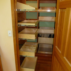 Closet and Walk-In Pantries - Pull out pantry shelves extend to allow access to the back of the shelf