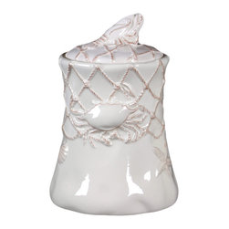 Urban Trends Collection - Ceramic Canister with Lid - Update your home decor with this trendy ceramic canister with a lid. This decorative canister features a stylish ocean and net theme.