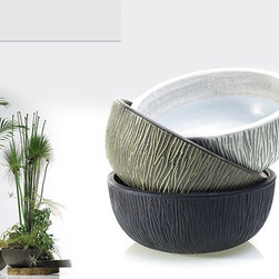 "Tinley Ceramic Low Bowl Planter - Add some appealing texture to your home or office with the Tinley Ceramic Low Bowl Planter. Made of weighty ceramic, this substantial bowl-shaped planter has a matte finish and organic texture that almost looks like tree bark. Because it does not have drainage holes, it's perfect for indoor use and is one of the best containers for herbs. This ceramic planter is is available in three colors: black, white, and brown. Choose from two sizes: 13"" diameter by 5.25"" high, or 16.25"" diameter by 6.5"" high."