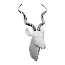 Interior Illusions - Kristina Kudu Head - Make a dramatic statement with the Kristina Kudu Head. Handmade with a white resin finish and long silver spiral horns, this kudu head makes an ideal focal point in a living or dining room. Pair it with modern decor for a sleek, bold look.