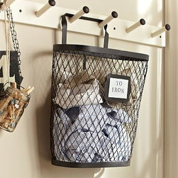 """Kandall Wire Hanging Wire Bin - Storage should be smart and stylish, and crafted for optimal organization. This sturdy hanging bin keeps laundry or mudroom accessories close at hand while saving floor space. 15"""" wide x 7.25"""" deep x 20.25"""" high Made of iron with a bronze finish. Catalog / Internet only."""