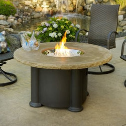 "Outdoor GreatRoom 48 in. Colonial Fire Pit Table - The robust Outdoor Greatroom 48 in. Colonial Fire Pit Table is a versatile piece of outdoor furniture with a center that opens to accommodate a stainless steel burner or an optional beverage bowl (sold separately). The mocha tabletop is cast with superstone for a surface that is as attractive as it is reliable. A large fiberglass base features a hidden side panel that conceals a 20 lb. propane tank easily. The stainless steel burner is capable of turning your natural gas or propane into a long-lasting heat with an output of 60 000 BTUs creating a cozy place to relax even on the coldest nights. The roaring flames ascending from the table's center add an impressive atmosphere to your exterior decor and may be managed to rise high or stay low with a convenient adjustable flame control. The Colonial Fire Pit is a beautiful table guaranteed to make your patio or garden more inviting. Measures 48 diam. x 25.25H inches About Outdoor GreatRoom CompanyWith over 50 patents to its name the Outdoor GreatRoom Company is one of the most innovative names in gas fireplaces and outdoor design period. Since 1975 Dan Ron Steve and Ger have produced a yard of amazing products like the Heat-N-Glo that have changed the industry. In fact they want to change the way you think about your backyard or patio. It's about bringing the luxury and comfort of the living room outside to make an """"Outdoor Room."""" They want you to literally think outside the box. To make that beautiful concept a reality Outdoor GreatRoom designs manufactures and sells pergolas outdoor kitchens grills outdoor furniture fireplaces fire pits lighting and heating products. There's no better name in outdoor leisure than this fine Minnesotan company."