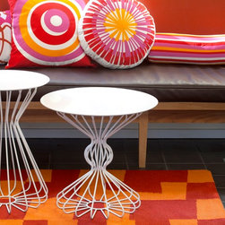 SHOP WITH US - white modern spindle outdoor tables, orange, red and pink fun outdoor pillows and rugs.